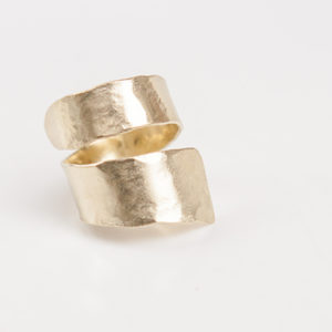 This delicate piece is handmade from 24-karat gold  plated brass with a lightly hammered finish for added shine. Wear it as the label intended - stacked with similar styles.